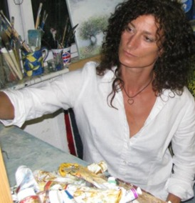 A photo of Kate Richardson at work in her studio