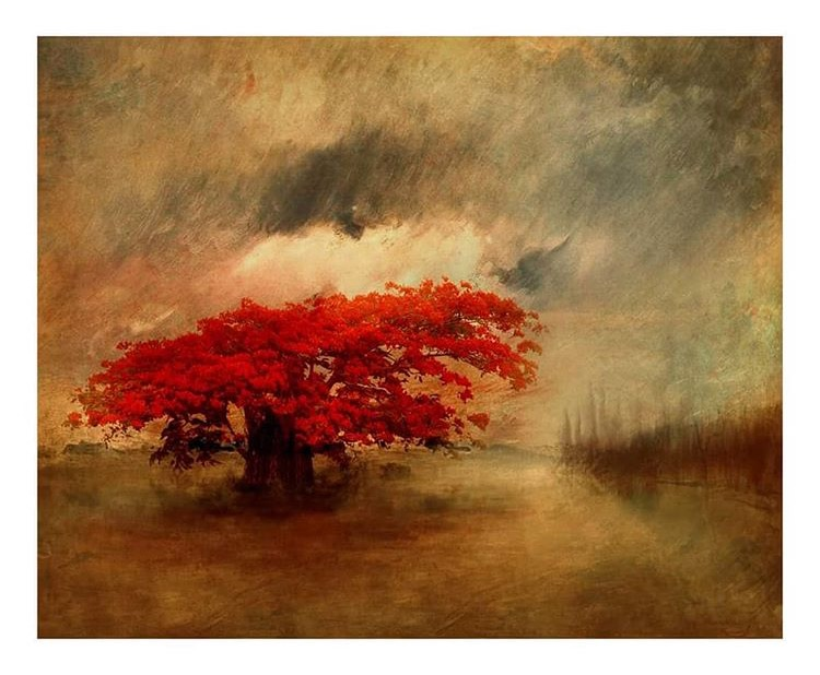 A painterly expressionistic view of a tree with bright red leaves